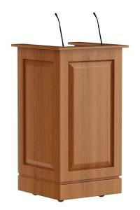 Klassiek houten spreekgestoelte met moderne oplossingen. Ter bescherming is het hout gespoten. Leverbaar als maître d'station voor in de horeca met afsluitbare deuren en lade. In het bovenblad zijn 1 of 2 shock mount voor de microfoon(s) mogelijk. De optionele leesplank is uitneembaar.  Classic wooden lectern with modern solutions. For protection the wood is sprayed. Available as maitre d station for hospitality industry with lockable doors and drawer. You can choose for 1 or 2 shock mount(s) for the microphone(s). The optional reading desk is removable.  Klassisches hölzernes Rednerpult mit modernen Lösungen. Zum Schutz des Holzes wird es lackiert. Erhältlich als Maître d'Station für die Hotel- und Gastronomiebetrieben, mit verschließbaren Türen und Schublade.
